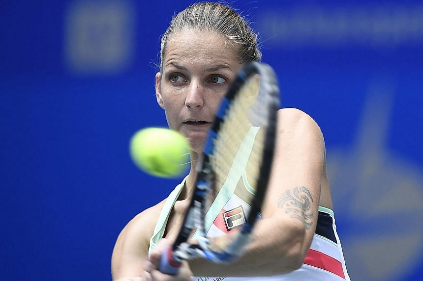 Czech Karolina Pliskova (top) returning against Australia's Ashleigh Barty (above) during their women's singles quarter-final match at the WTA Wuhan Open. The world No. 4 failed to usurp top-ranked Garbine Muguruza of Spain as a result of her loss.