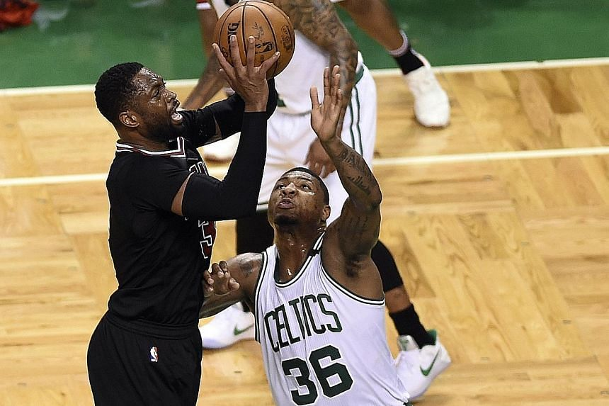 Dwyane Wade (left) shooting past Boston Celtics guard Marcus Smart in April. A three-time NBA champion and the Most Valuable Player of the 2006 Finals, Wade averaged 18 points a game for the Chicago Bulls last season.