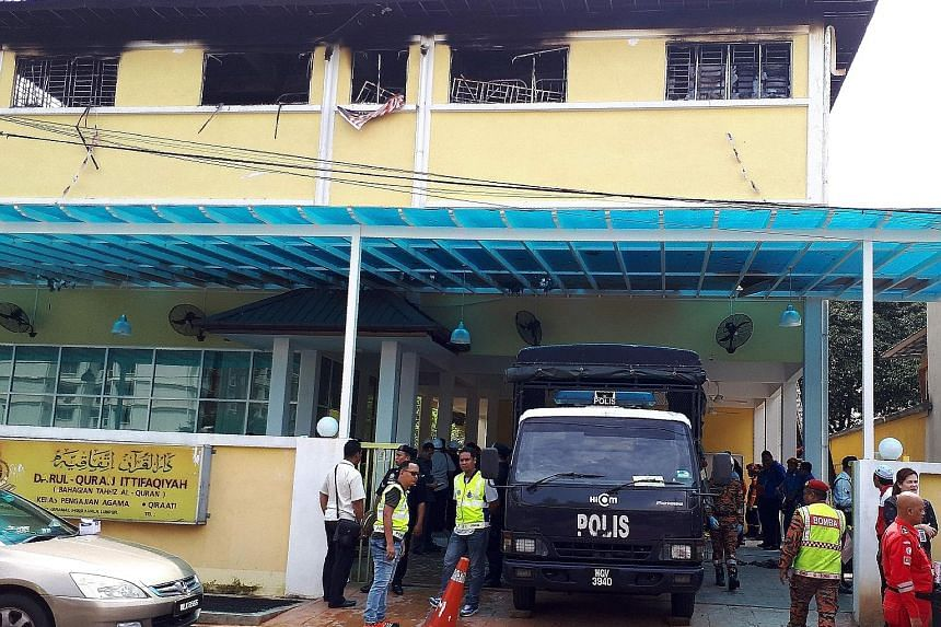 Victims were trapped behind barred windows in the pre-dawn blaze at the Darul Quran Ittifaqiyah Tahfiz centre in Kuala Lumpur on Sept 14. Police said the fire was started by teens in a spat with some students.