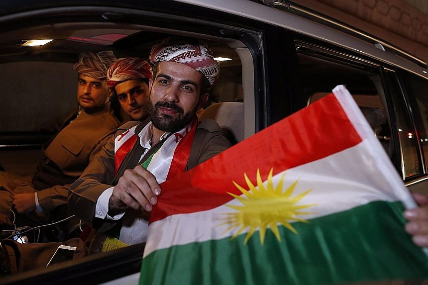 Kurds celebrating after the announcement of the independence referendum results, which show 92.73 per cent of voters backed statehood.