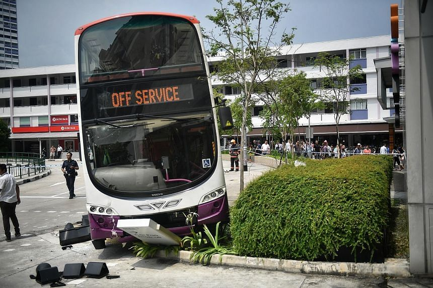 SCDF officers had to use lifting equipment to rescue the woman who was trapped under the bus.