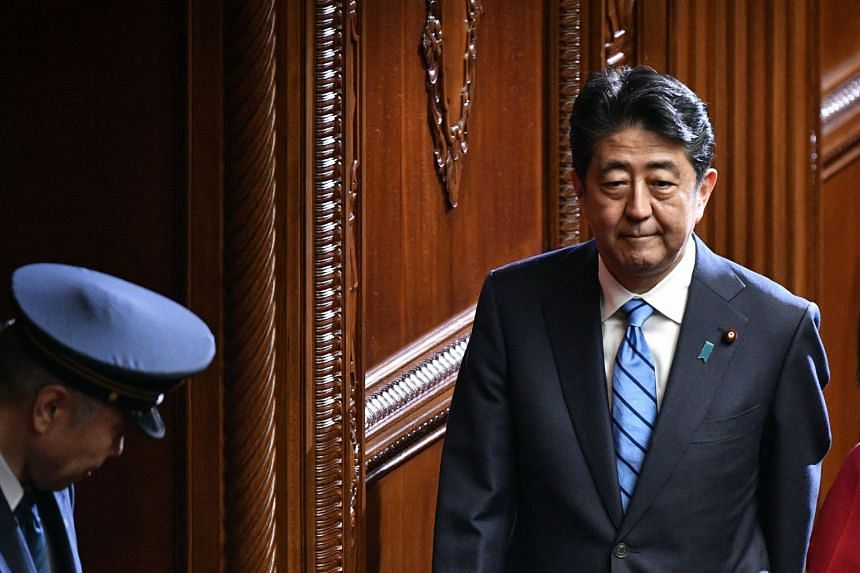 """Japanese Prime Minister Shinzo Abe claimed that his government """"put an end"""" to Japan's decades-long economic slump after he took office in late 2012 in a landslide election victory."""