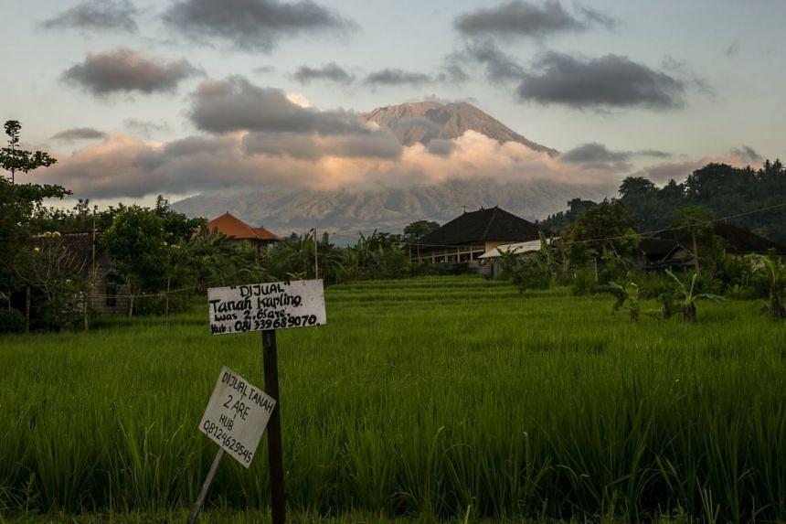 Mount Agung is seen from Subagan village in Karangasem, Bali.