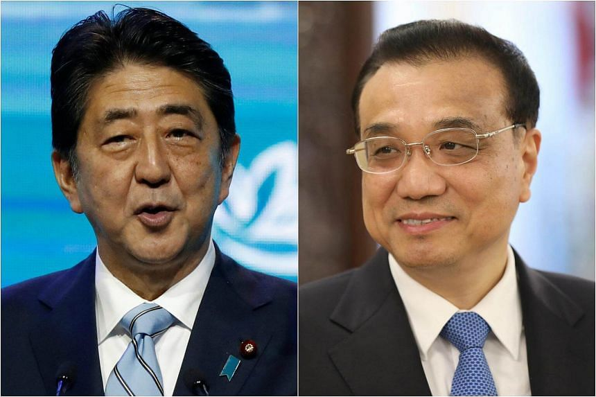Chinese Premier Li Keqiang (right) and his Japanese counterpart Shinzo Abe exchanged congratulatory messages via telegraph on Friday (Sept 29) to mark the 45th anniversary of the normalisation of diplomatic ties of the two countries.