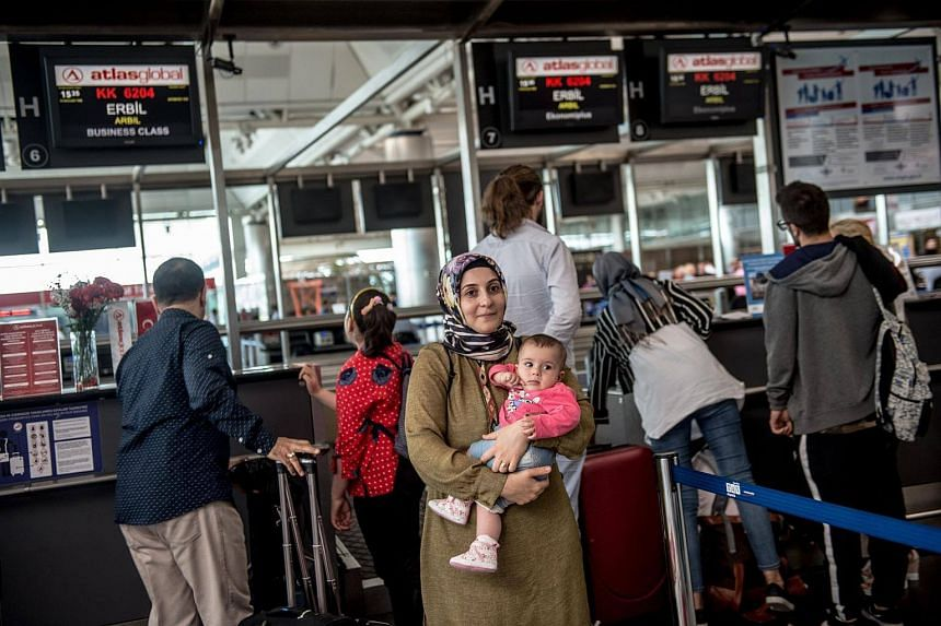 Passengers flying to Arbil wait to check-in for their flight at Ataturk International airport in Istanbul, on Sept 28, 2017.