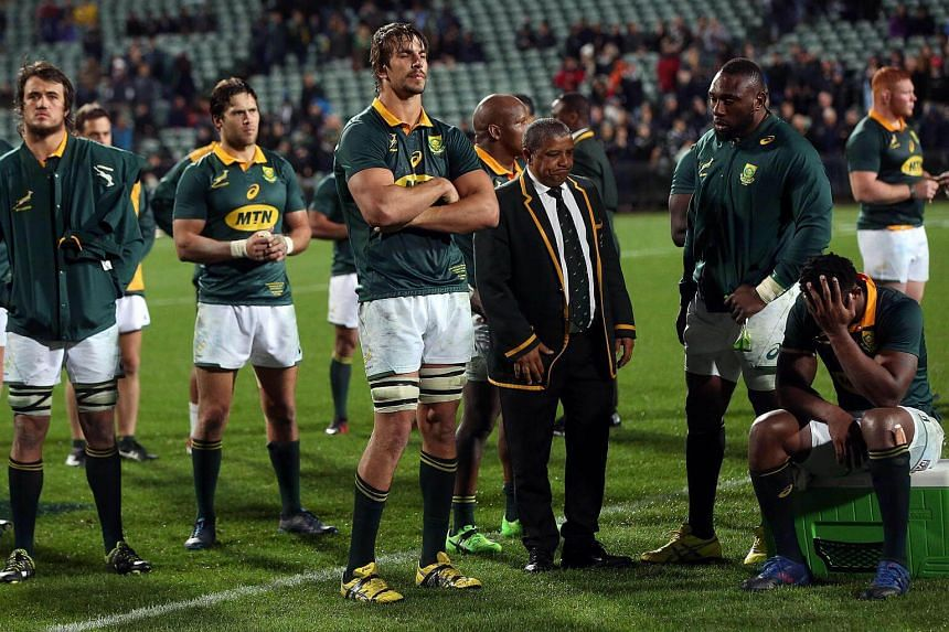 South Africa's coach Allister Coetzee and teammates look on after the Rugby Championship match between New Zealand and South Africa at Albany Stadium in Auckland on Sept 16, 2017.