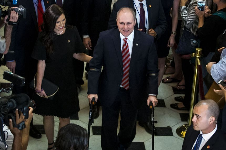 Steve Scalise walks with his wife, Jennifer, as he returns from the House floor on his first day back at the US Capitol.