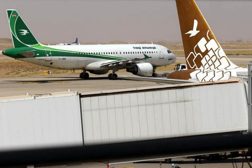 An Iraqi airways plane is pictured on the tarmac at Erbil airport, in the northern Kurdish region, on Sept 28, 2017. Almost all foreign airlines suspended flights to Erbil and Sulaimaniya, obeying a notice from the government in Baghdad.