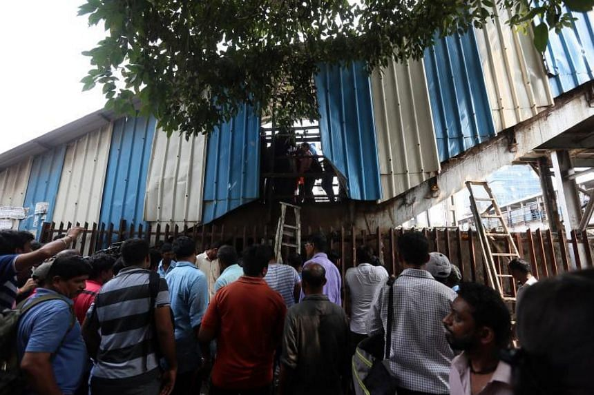 Eyewitnesses described people being trampled under a panicked crowd on a pedestrian bridge at Elphinstone station.
