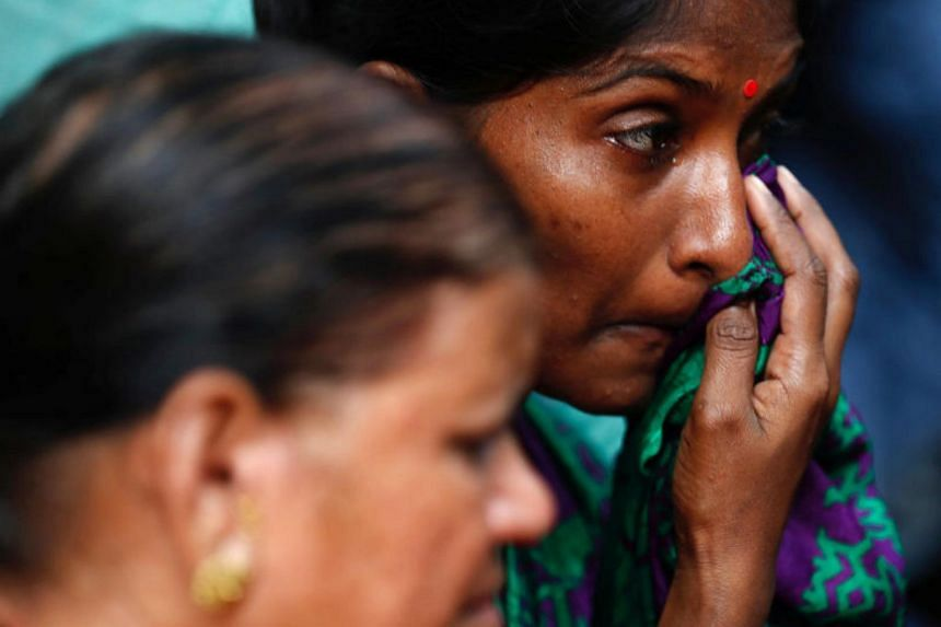 Relatives of a stampede victim grieve at a hospital in Mumbai, India on Sept 29, 2017.