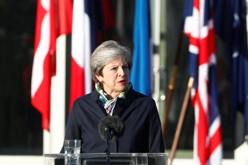 Britain's Prime Minister Theresa May makes a statement as she visits NATO Enhanced Forward Presence (EFP) battalion battle group in Tapa, Estonia on Sept 29, 2017.