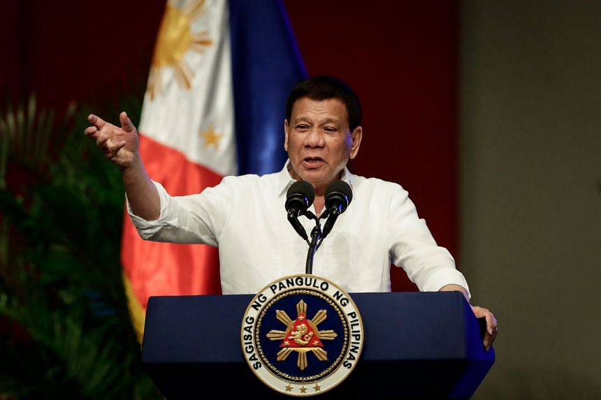Philippine President Rodrigo Duterte gestures during his speech in Pasay City, south of Manila, Philippines, on Sept 26, 2017.