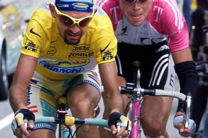 A photo taken on July 27, 1998 during the Tour de France shows the yellow jersey Italian Marco Pantani riding with German Jan Ullrich.