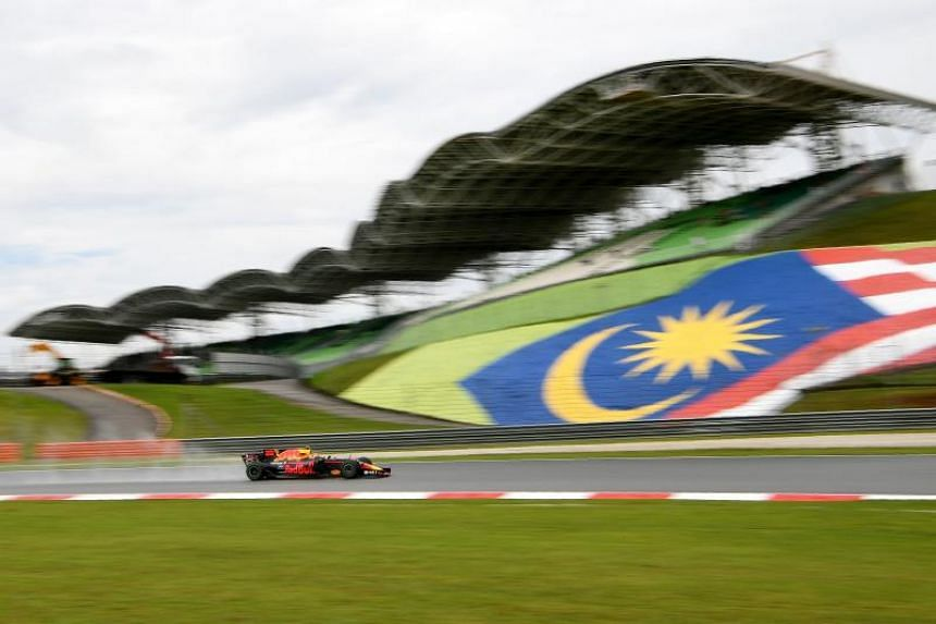 Red Bull's Dutch driver Max Verstappen powers his car during the first practice session of the Formula One Malaysia Grand Prix in Sepang on Sept 29, 2017.