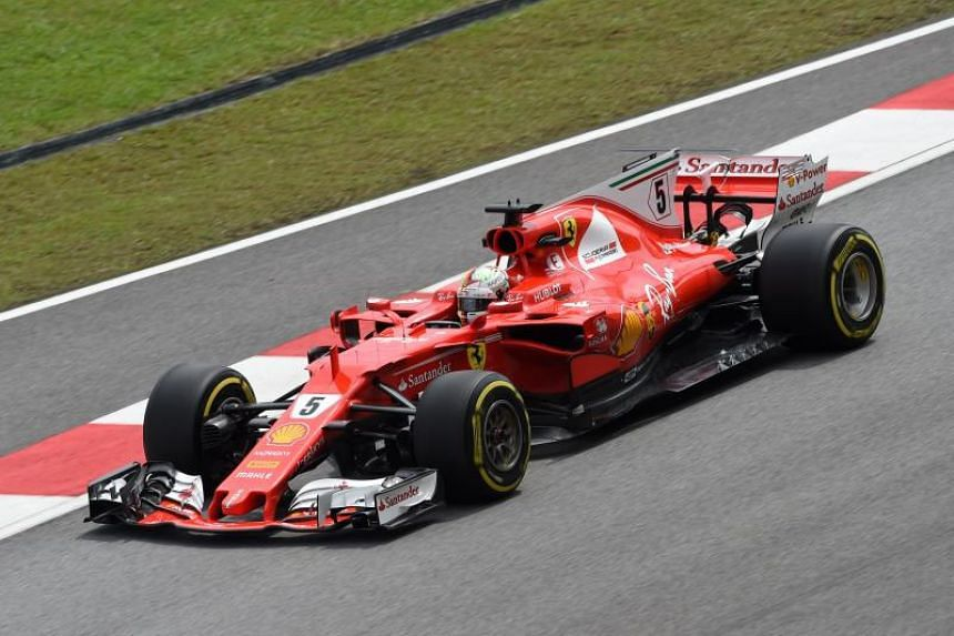 Ferrari's Sebastian Vettel drives during his second practice session of the Formula One Malaysia Grand Prix at the Sepang circuit on Sept 29, 2017.