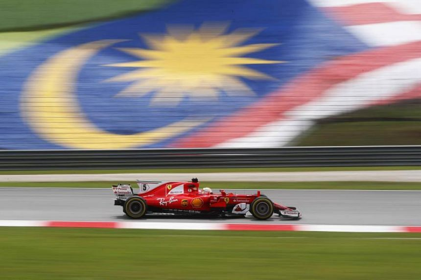"Ferrari's Sebastian Vettel during practice at the Malaysian Grand Prix on Sept 29, 2017. Sepang International Circuit's chief executive Razlan Razali has said that the Malaysian Grand Prix is ""200 per cent"" cancelled after the race in 2017."