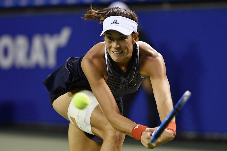 Garbine Muguruza of Spain in action against Monica Puig of Puerto Rico during the women's singles second round match at the Pan Pacific Open women's tennis tournament in Tokyo, Japan, on Sept 20, 2017.