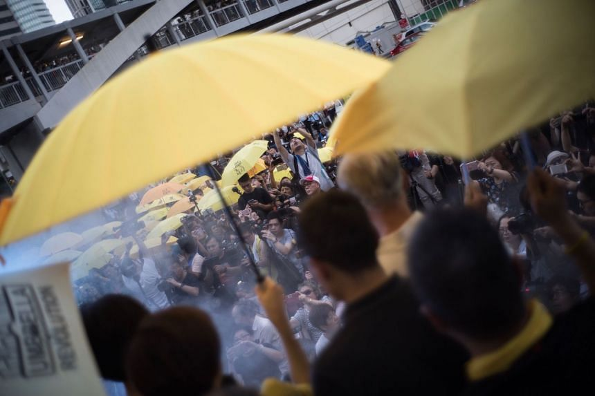 Smoke replicating tear gas that was fired by police during a gathering marking the third anniversary of the Umbrella Movement on Sept 28, 2017.