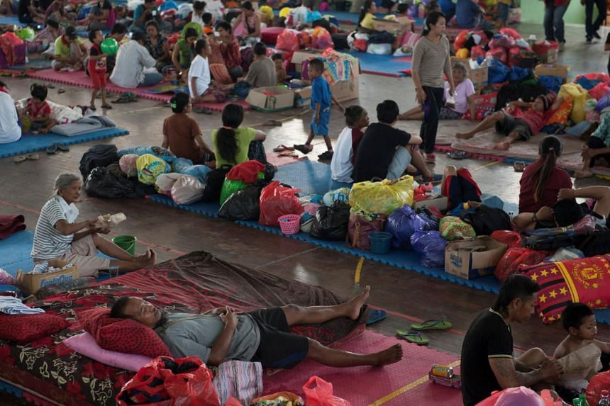 Villagers rest at a temporary evacuation center for people living near Mount Agung in Bali, Indonesia, on Sept 28, 2017.