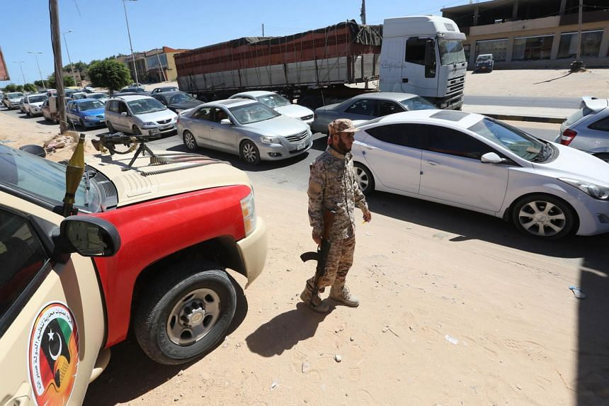 Members of a Libyan force tackling clandestine migration man a checkpoint in Sabrata, about 70 km west of Tripoli on Sept 11, 2017.