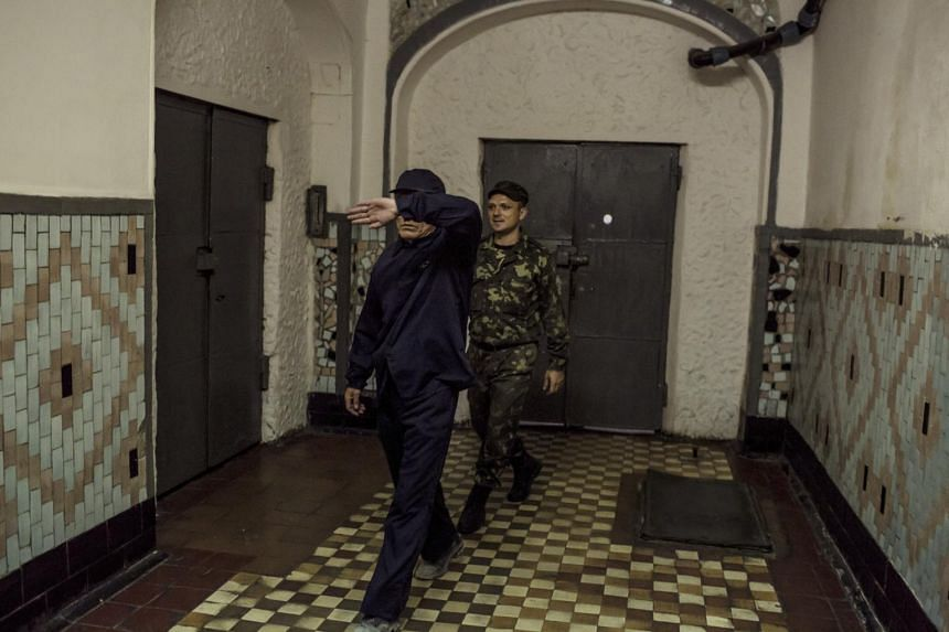Ri Tae Gil (left), a North Korean spy convicted of trying to photograph classified materials on Ukrainian rocket engines in 2011, a situation that turned out to be a sting operation, at the No. 8 Prison in Zhytomyr, Ukraine, on Sept 7, 2011.
