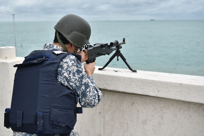 RSN and SPF personnel in a joint contingency response exercise on Pedra Branca in August.