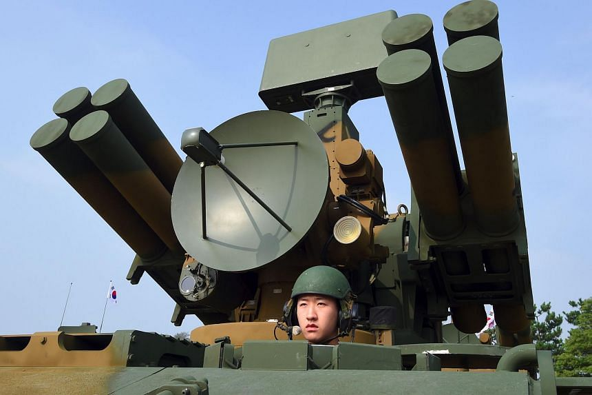 A South Korean soldier sitting on a Chunma self-propelled short range air defense missile system on Sept 25, 2017.