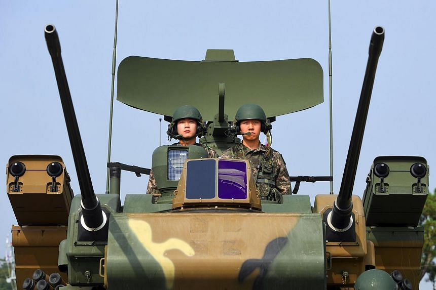 South Korean soldiers sitting on a K30 Biho twin 30 mm self-propelled anti-aircraft weapon on Sept 25, 2017.