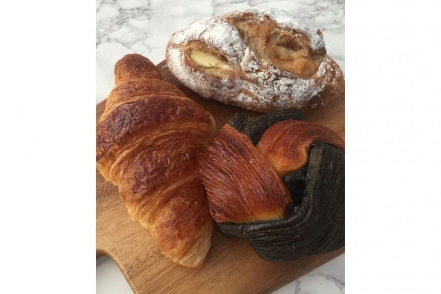 """(Clockwise from far left) """"Tak kiu"""" croissant, fig and cream cheese campagne and the signature """"sor hei"""", a Danish pastry with chocolate chips at Keong Saik Bakery."""