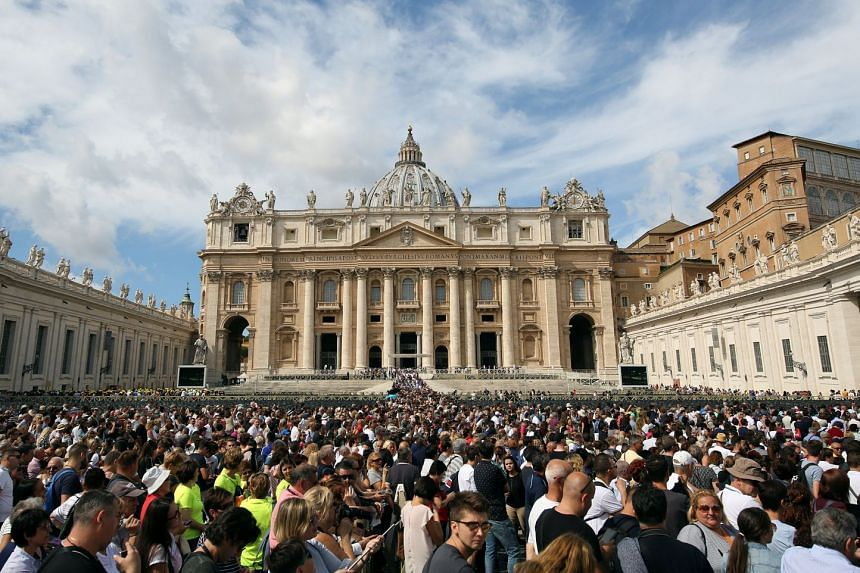 The faithful gather in front of St Peter's Basilica as Pope Francis leads prayers at the Vatican, Sept 17, 2017.