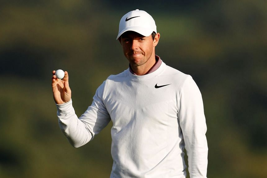 Northern Ireland's Rory McIlroy celebrates a birdie on the 17th hole during the second round.