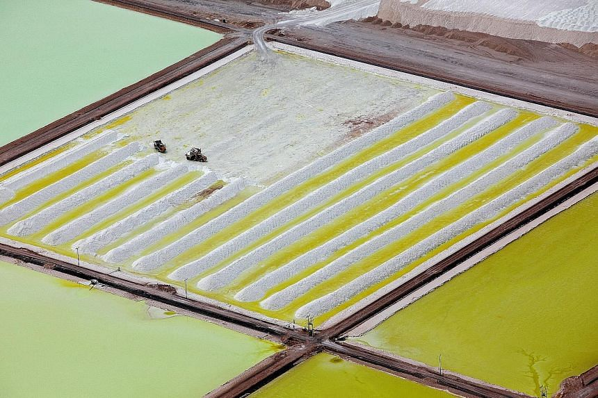 The brine pools and processing areas of the Soquimich lithium mine on the Atacama salt flat in Chile.