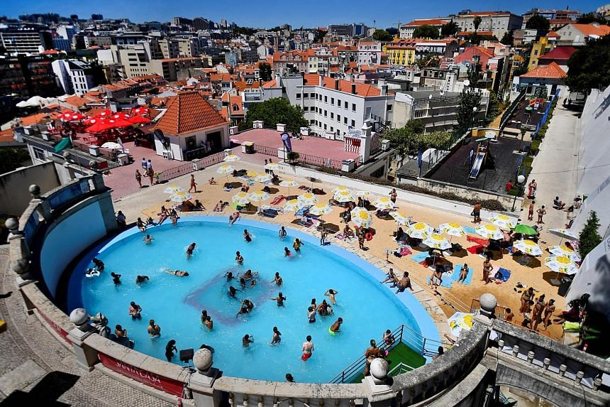 Leisure with views: Lisbon's Torel public pool (above) and a movie screening on the terrace of the Topo Chiado bar and restaurant.