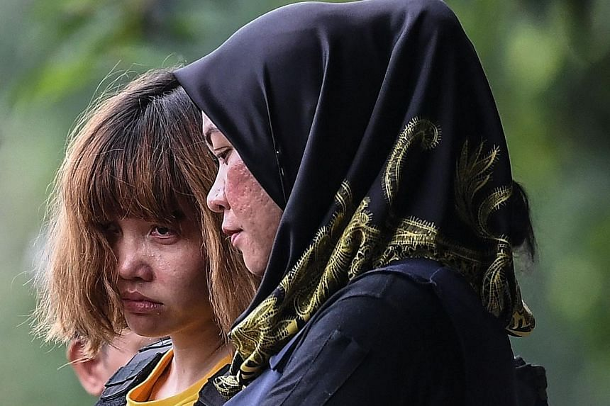 Vietnamese national Doan Thi Huong (left) being escorted after a court appearance in March. Her lawyer said she has a good defence when her trial opens on Monday, and that there is evidence to support it.