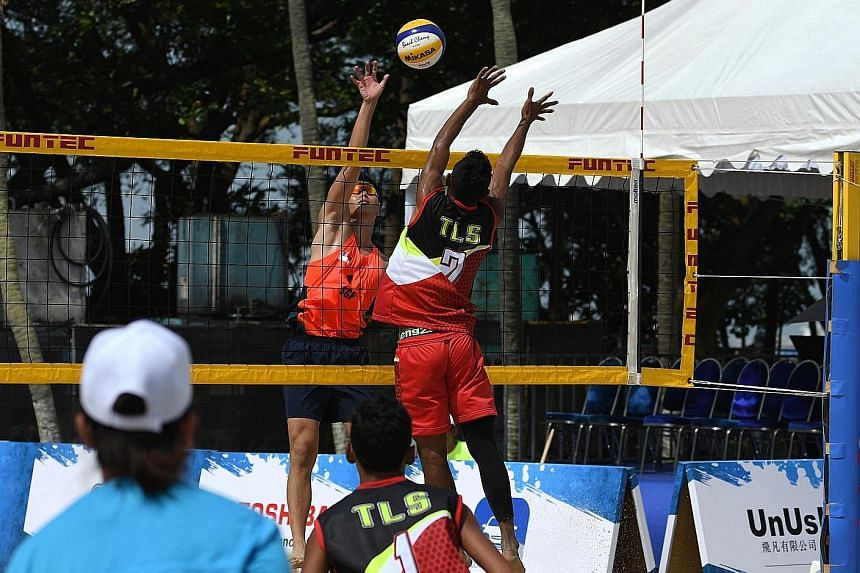Singapore's Poon Pei Jie and Timor Leste's Jean da Silva facing off at the net during their pool-stage clash at the South-east Asian Beach Volleyball Championships on Sentosa's Palawan Beach on Thursday. Poon and Mark Shen lost in the quarter-finals