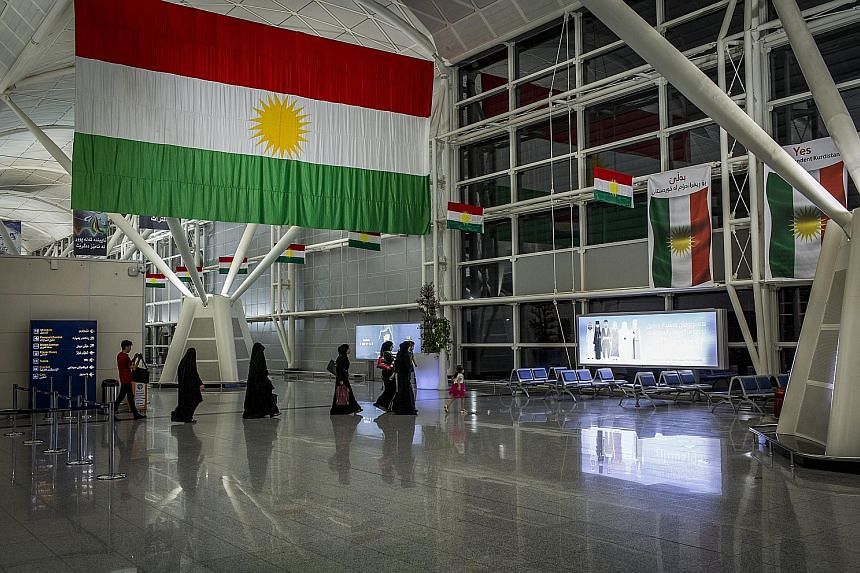 Kurdistan flags adorn the airport in Erbil, Iraq. The Baghdad government has ordered the Kurdish authorities to surrender control of the region's two international airports, and has banned all international flights to the region.