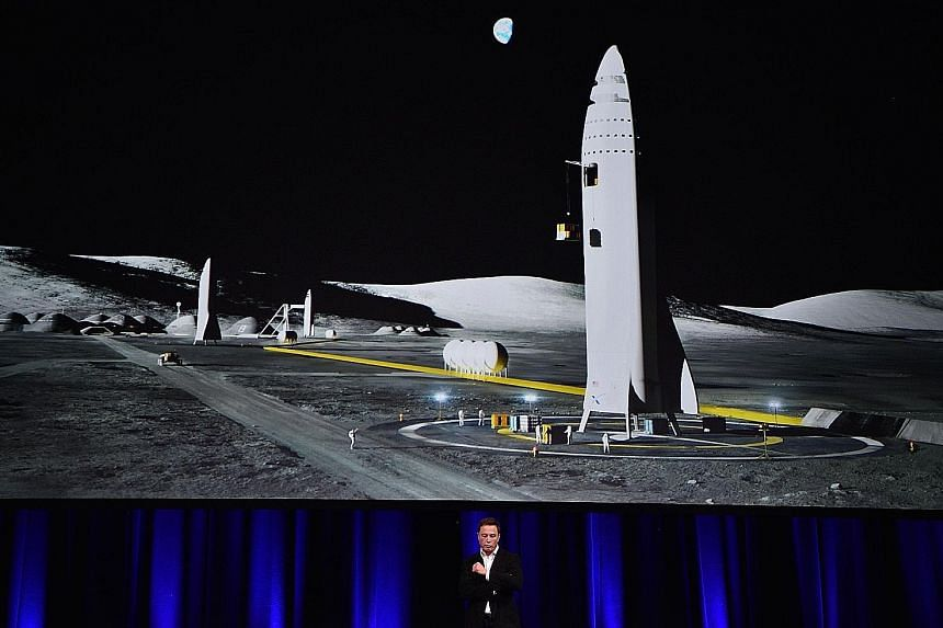 Mr Elon Musk with an illustration of his rocket, which he says will be completed and launched in about five years.
