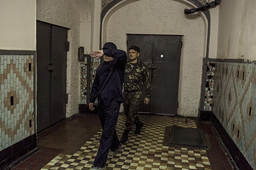 "Convicted North Korean spy Ri Tae Gil (left) in the No. 8 Prison in Zhytomyr, Ukraine, in 2011. Deputy warden Anatoly Gabitov describes Ri as a ""super inmate"" who never causes trouble."