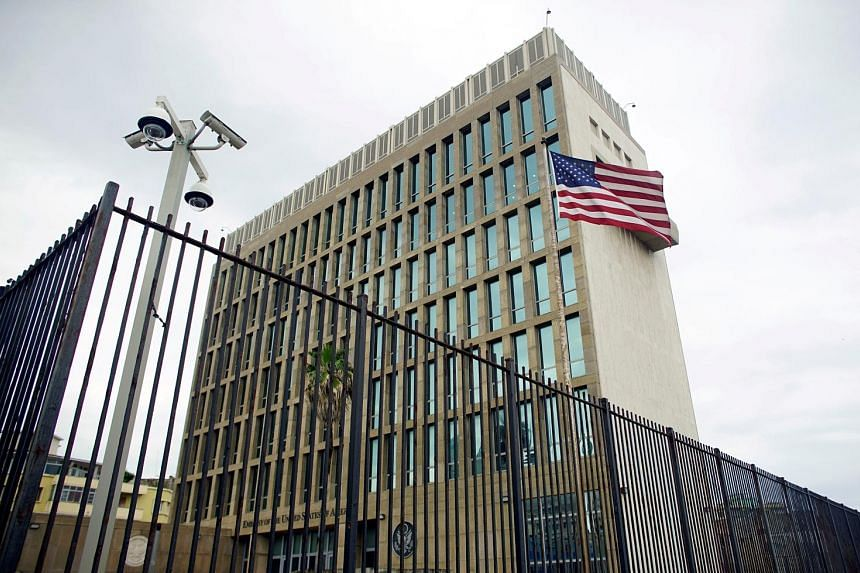 The American embassy in Havana (right) will stop processing visas and is set to issue a new travel warning, saying that some attacks occurred in Cuban hotels and US tourists could be exposed if they travel to Cuba.