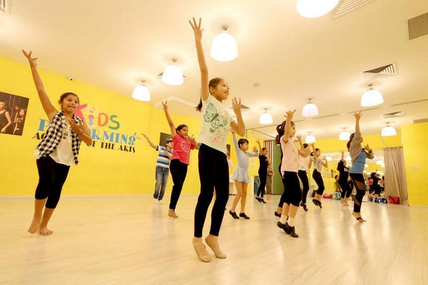 The 16 dancers who will perform for ChildAid 2017 during their rehearsals at the Kids Performing Academy for the Arts, led by trainer Samantha Kan (extreme right).
