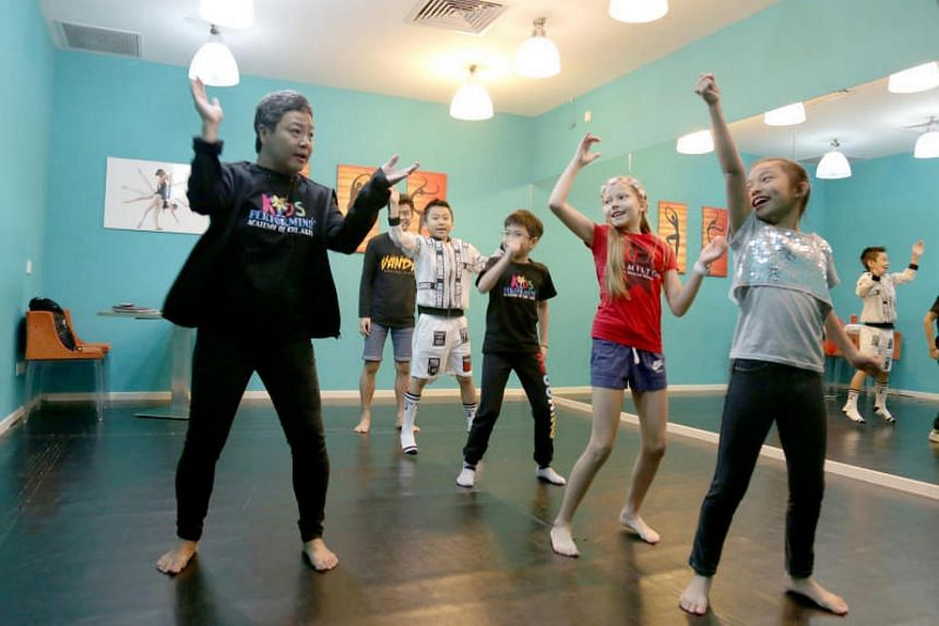 Trainer Kuo Po (extreme left) during rehearsals with the lead roles for ChildAid2017.