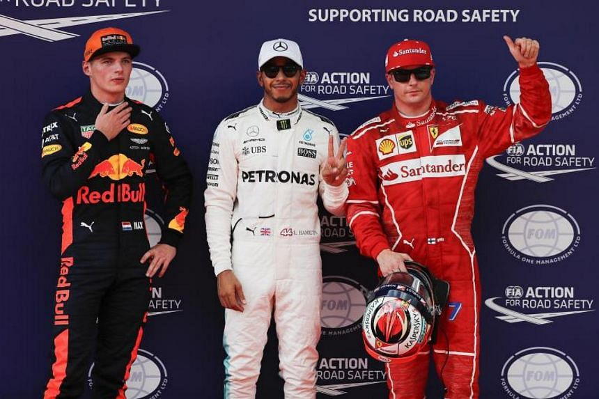 Briton Lewis Hamilton (centre) of Mercedes took pole, Finn Kimi Raikkonen (right) of Ferrari second and Dutchman Max Verstappen of Red Bull third for the  2017 Formula One Grand Prix of Malaysia.