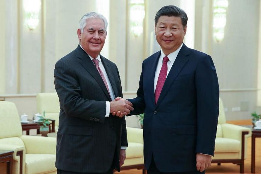 US Secretary of State Rex Tillerson (left) with Chinese President Xi Jinping before their meeting at the Great Hall of the People in Beijing on Sept 30, 2017.