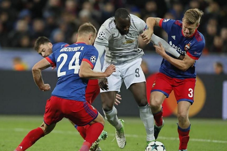 Vasili Berezutski (left) and Pontus Wernbloom of CSKA Moscow in action against Romelu Lukaku of Manchester United during the Uefa Champions League Group A match at VEB Arena in Moscow, Russia on Sept 27, 2017.