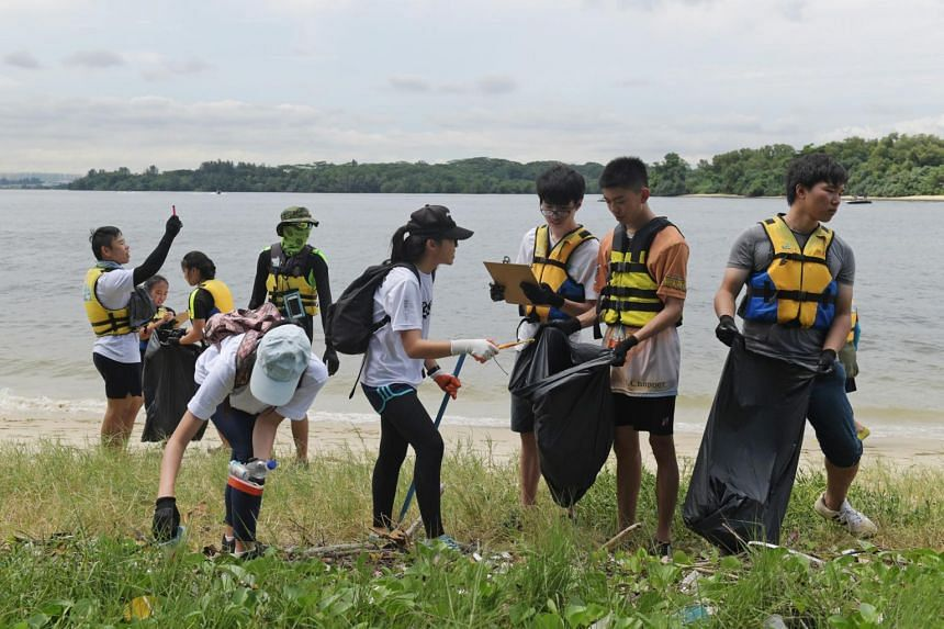 About 100 volunteers went to Seletar Island to collect marine trash in an event organised by the Maritime and Port Authority of Singapore, in conjunction with the International Coastal Clean-up, on Sept 30, 2017.