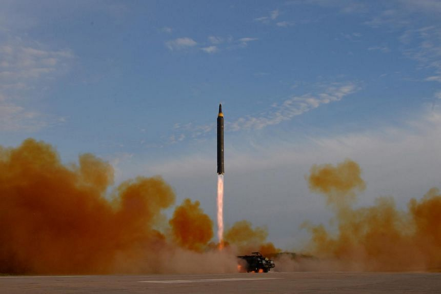 North Korean leader Kim Jong Un (not pictured) guides the launch of a Hwasong-12 missile in this undated photo released by North Korea's Korean Central News Agency, on Sept 16, 2017.