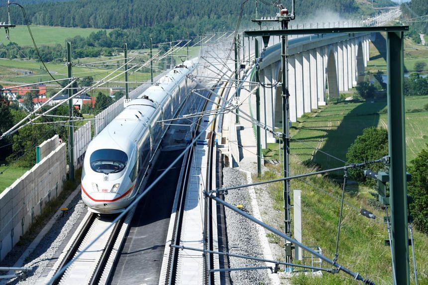 The man, who is believed to be Romanian, held on to the side of a high-speed train in Germany for 25km.