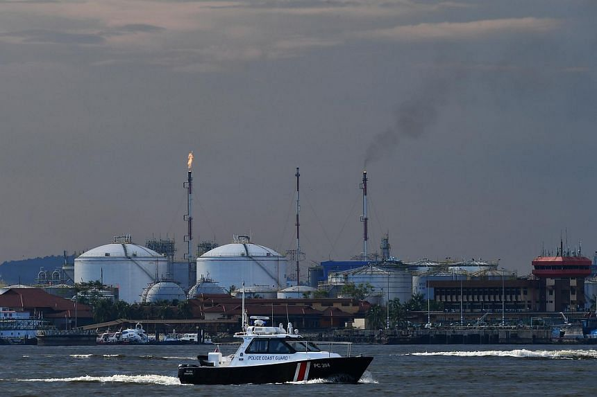 Gas flaring activities in progress at one of the petrol chemical plants in Pasir Gudang, Malaysia, as seen from Punggol Point Jetty on April 7, 2017.