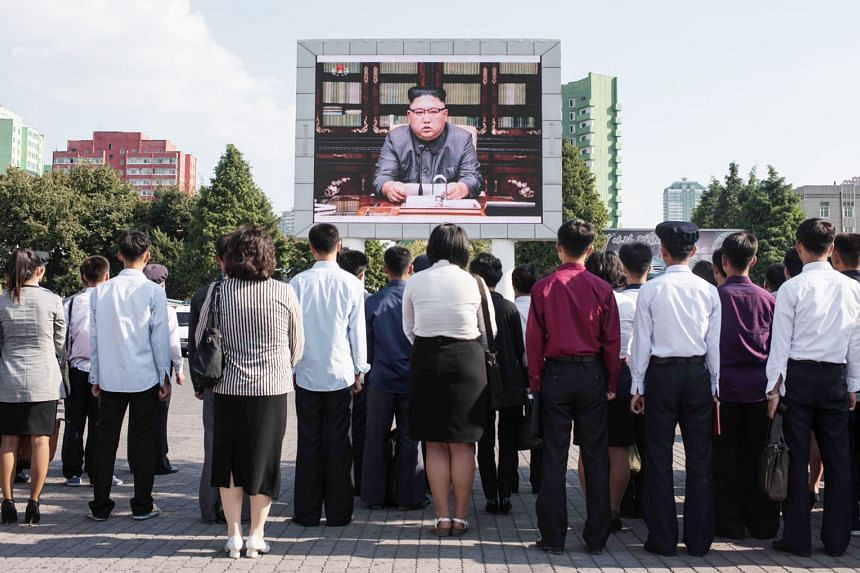 """North Koreans watching a TV broadcast of their leader Kim Jong Un giving a statement on Sept 22 in which he blasted US President Donald Trump as being """"mentally deranged"""". He also warned that Mr Trump will """"pay dearly"""" for his threat to destroy North"""