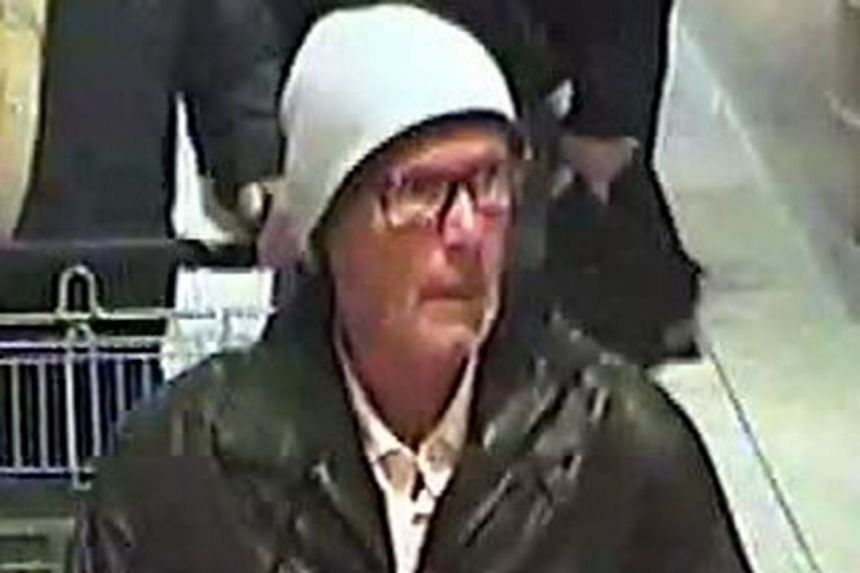 A police photo shows a CCTV grab of a suspected blackmailer in a Friedrichshafen supermarket.